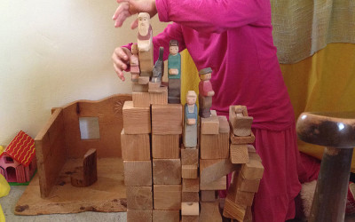 Playing with the wooden toys